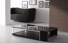 Black Coffee Tables That Give A Sophisticated Look To Your Room | www.bocadolobo.com #sophisticatedcoffeetable #coffeetable #centertable #luxury #luxurybrands #luxurious #livingroom #sittingroom #roomdesign Black Coffee Table Black Coffee Tables That Give A Sophisticated Look To Your Room Contemporary Coffee Table Decorations 240x150